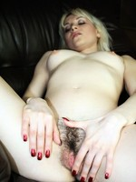 sexy blonde amateur rubs her hairy pussy
